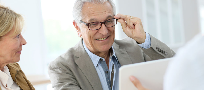 man trying on eyeglasses